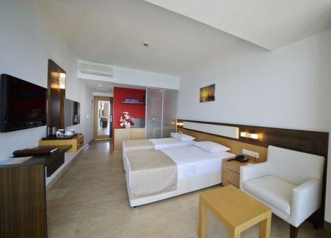 Hotelzimmer mit Mountainbike im Yalihan Una