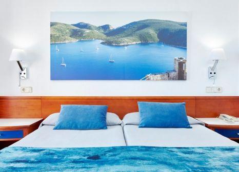 Hotelzimmer mit Mountainbike im Universal Hotel Romantica
