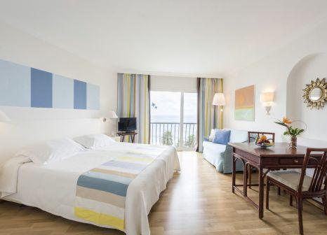 Hotelzimmer mit Mountainbike im OCÉANO Hotel Health Spa