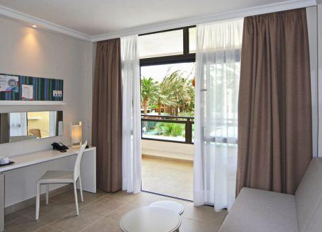 Hotelzimmer mit Mountainbike im TUI FAMILY LIFE Orquidea