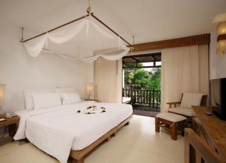 Hotelzimmer mit Mountainbike im Aana Resort