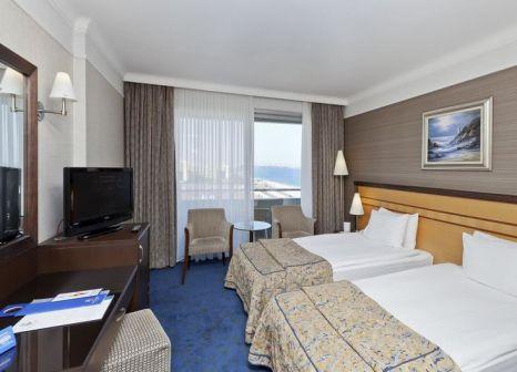 Hotelzimmer mit Mountainbike im Porto Bello Hotel