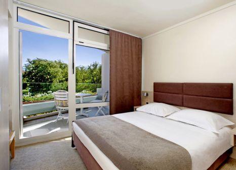 Hotelzimmer mit Mountainbike im Hotel Mediteran Plava Laguna