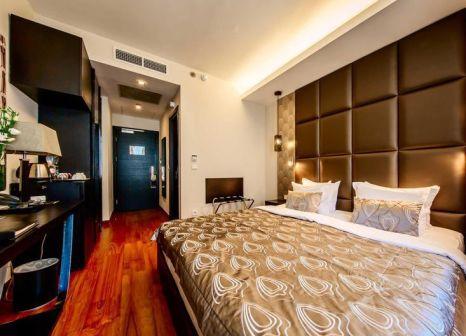 Hotelzimmer mit Hochstuhl im Continental Hotel Budapest