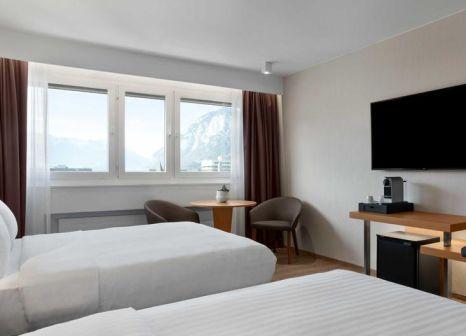 Hotelzimmer mit Ski im AC Hotel Innsbruck