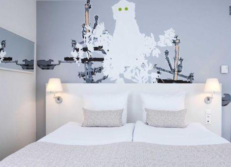 Hotelzimmer mit Hochstuhl im Hotel NH Brussels Bloom