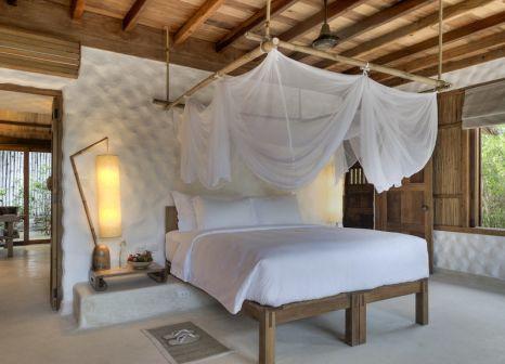 Hotelzimmer mit Mountainbike im Six Senses Ninh Van Bay