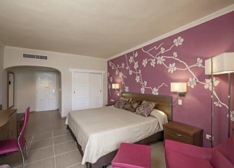 Hotelzimmer mit Mountainbike im Iberostar Daiquiri