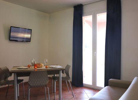 Hotelzimmer mit Mountainbike im Ai Pozzi Village & Spa