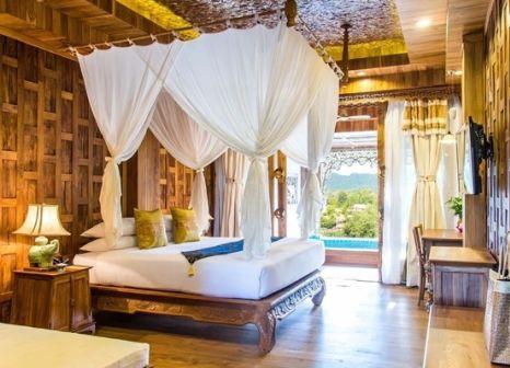 Hotelzimmer mit Volleyball im Santhiya Tree Koh Chang Resort