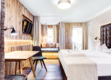 Hotelzimmer mit Mountainbike im Dolomiten Residenz Sporthotel Sillian