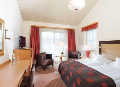 Hotelzimmer mit Mountainbike im Travel Charme Ostseehotel Kühlungsborn