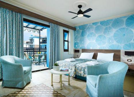 Hotelzimmer mit Mountainbike im Aldemar Royal Mare Luxury & Thalasso Resort