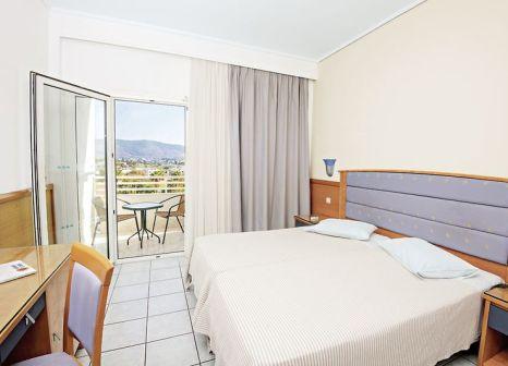 Hotelzimmer mit Mountainbike im Atlantis Hotel