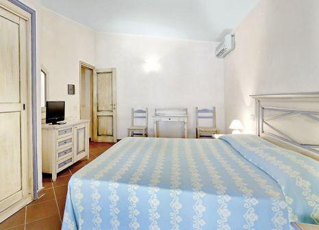 Hotelzimmer mit Mountainbike im Colonna Country & Sporting Club