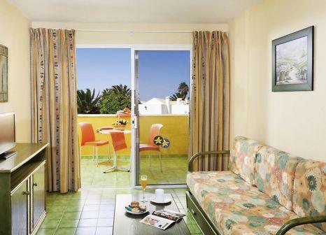 Hotelzimmer mit Mountainbike im Aparthotel Caleta Garden