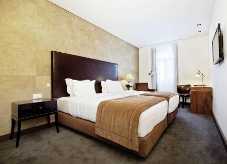 Hotelzimmer mit Spielplatz im Lisboa Carmo Hotel