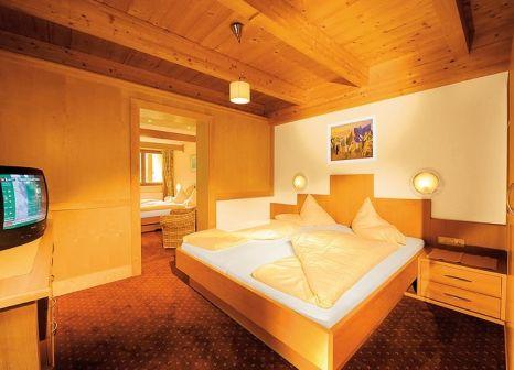 Hotelzimmer mit Ski im Hotel Sunny Sölden