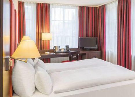 Hotelzimmer mit Mountainbike im NH Salzburg City