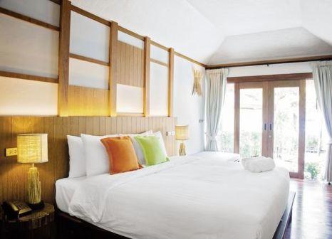 Hotelzimmer mit Paddeln im Tup Kaek Sunset Resort