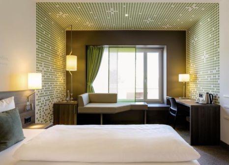Hotelzimmer mit Mountainbike im Vienna House Zur Bleiche Schaffhausen