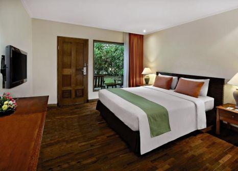 Hotelzimmer mit Mountainbike im Mercure Resort Sanur