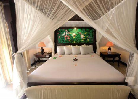Hotelzimmer mit Mountainbike im Puri Mas Boutique Resort & Spa