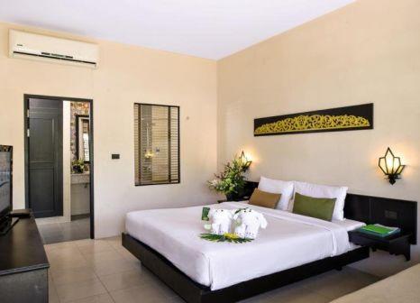Hotelzimmer mit Tischtennis im Deevana Patong Resort & Spa
