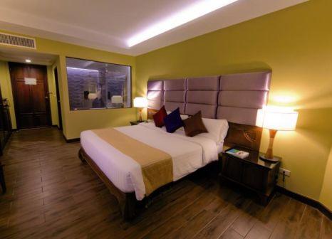 Hotelzimmer mit Mountainbike im Nora Beach Resort & Spa