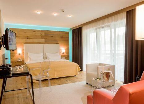 Hotelzimmer mit Mountainbike im Alpinresort Sport & Spa