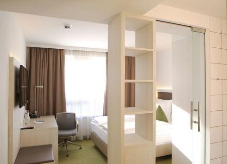 Hotelzimmer mit Mountainbike im Hotel Zeitgeist
