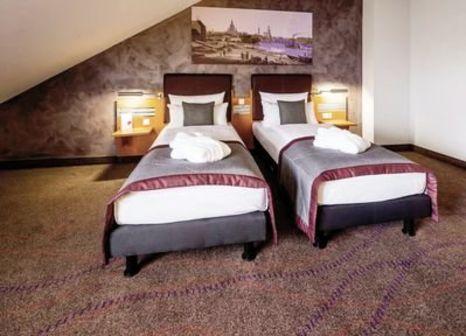 Hotelzimmer mit Hochstuhl im Wyndham Garden Dresden