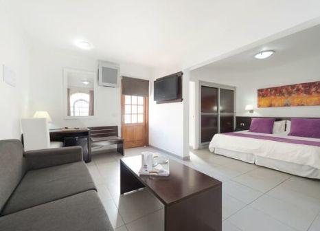 Hotelzimmer mit Mountainbike im eó Suite Hotel Jardín Dorado