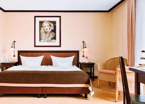 Hotelzimmer mit Hochstuhl im Maxx by Steigenberger Sanssouci Potsdam
