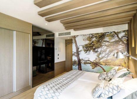 Hotelzimmer mit Mountainbike im Pure Salt Garonda