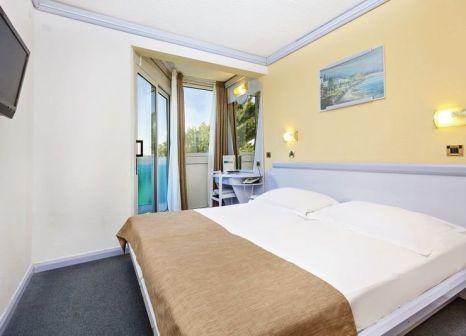 Hotelzimmer mit Mountainbike im Hotel Plavi Plava Laguna