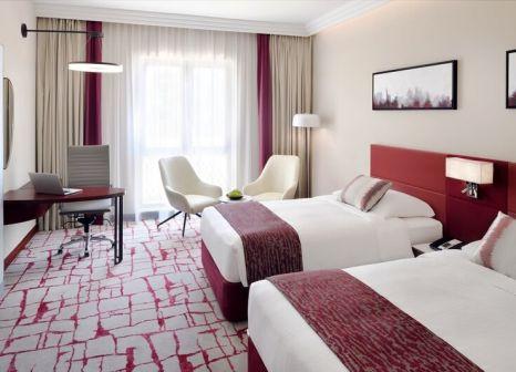 Hotelzimmer mit Tischtennis im Mövenpick Hotel & Apartments Bur Dubai
