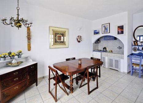 Hotelzimmer mit Mountainbike im Aegagros Caldera Houses