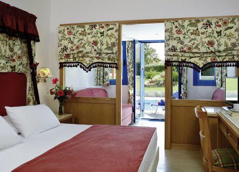 Hotelzimmer mit Mountainbike im Rinela Beach Resort & Spa