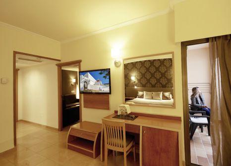 Hotelzimmer mit Mountainbike im Invisa Hotel La Cala