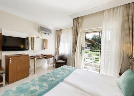 Hotelzimmer mit Mountainbike im Kamelya K Club