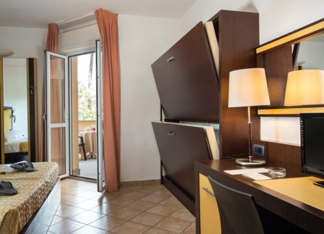 Hotelzimmer mit Mountainbike im Park Hotel Marinetta