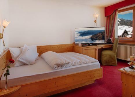 Hotelzimmer mit Mountainbike im Alpin Royal Wellness Refugium & Resort Hotel