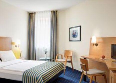Hotelzimmer mit Restaurant im InterCityHotel Stralsund
