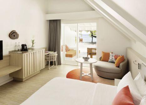 Hotelzimmer mit Mountainbike im LUX* South Ari Atoll