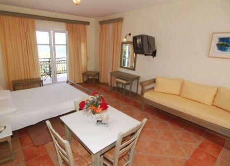 Hotelzimmer mit Mountainbike im Panselinos
