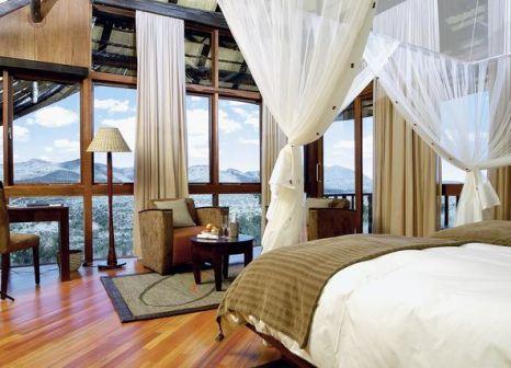 Hotelzimmer mit Mountainbike im GocheGanas Lodge