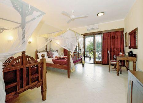 Hotelzimmer mit Tischtennis im Uroa Bay Beach Resort