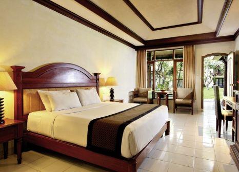 Hotelzimmer mit Mountainbike im Griya Santrian Resort