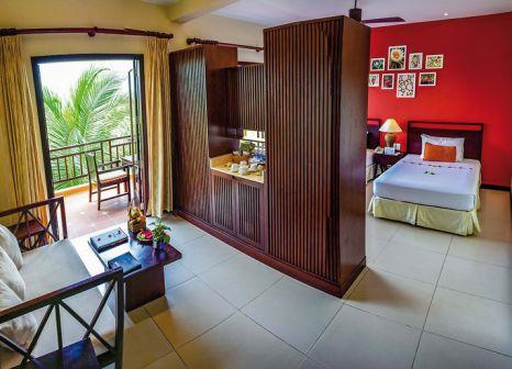 Hotelzimmer mit Mountainbike im Pandanus Resort